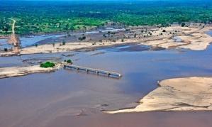 A broken bridge over the Licungo river after flooding in Zambezia province, Mozambique. Photograph: Antonio Silva/EPA