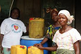 A Sierra Leonean small business woman dealing in palm oil.