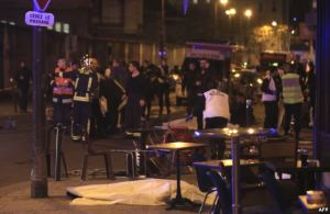 Rescue workers and medics work by victims in a Paris restaurant, Nov. 13, 2015.