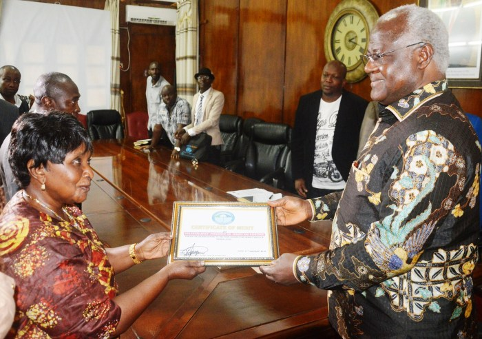 president receives certificate of merit