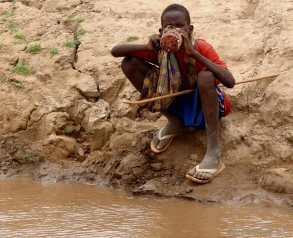 young-black-child-drinking-muddy-water