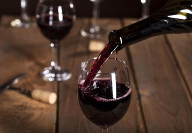 bottle-pouring-glass-of-red-wine