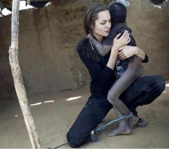 Angelina Jolie, UNHCR Goodwill Ambassador, holds a mentally disturbed boy in Sudan. Photo credit Flickr