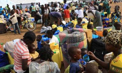 South Sudanese refugee families displaced by fighting gather at Imvepi settlement in Arua district
