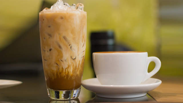 Close-Up Of Iced And Hot Coffee On Restaurant Table
