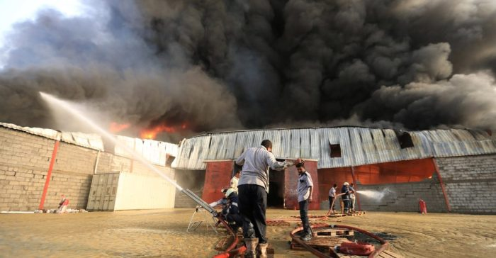 Firefighters try to extinguish a fire engulfing warehouse of the World Food Programme in Hodeida, Yemen