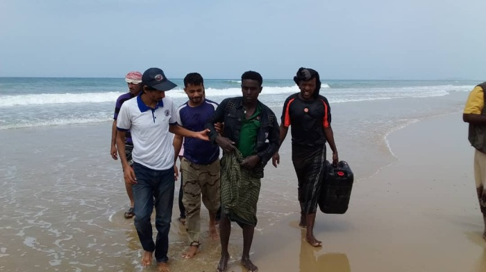 IOM Yemen staff assist a migrant who survived drowning
